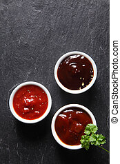 Assorted Hot Sauce on White Saucers - Aerial Shot of...