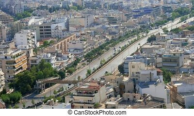 Aerial shot of Athens downtown with highways and modern...
