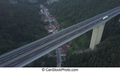 Aerial shot of Austrian highway bridge above small town in...