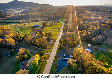 Aerial shot of backbit road in Georgia Mountains during the sunset in the Fall season