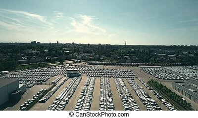 Aerial shot of big new car warehouse