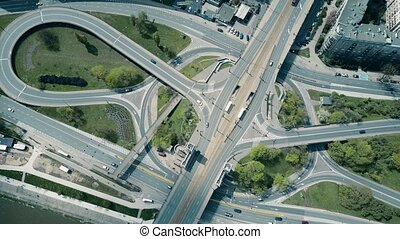Aerial shot of big urban road interchange. 4K video