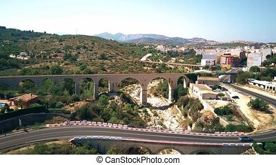 Aerial shot of bridges and dried river in Andalusia, Spain -...