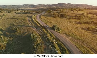 Aerial Shot of Car Moving on Curvy Mountain Road - Aerial...