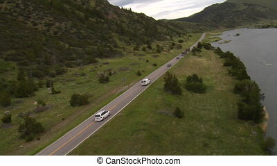 Aerial shot of cars driving on mountain highway