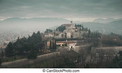 Aerial shot of Castle of Brescia on a foggy day, Italy