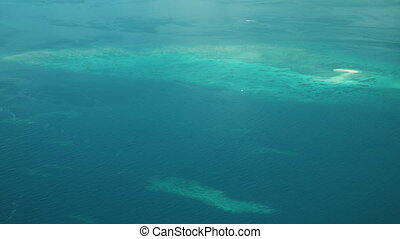 Aerial shot of corals from beneath the ocean - An aerial...