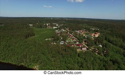 Aerial shot of cottages and lake - Aerial shot of lake shot