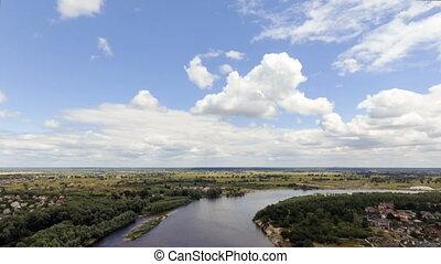 Aerial shot of deep blue river during summer