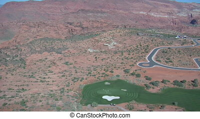 Aerial shot of desert golf course- high altitude