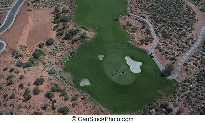 Aerial shot of desert golf course- high altitude