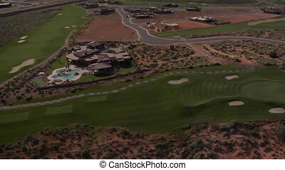 Aerial shot of desert golf course mansion- high altitude