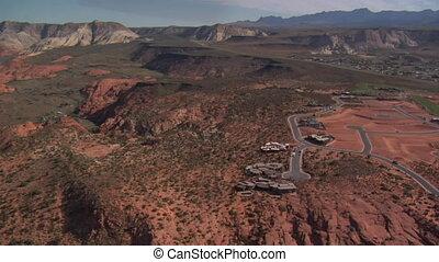 aerial shot of desert mansions