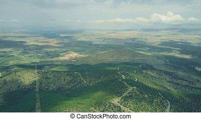 Aerial shot of distant solar power plant in Sierra Nevada...