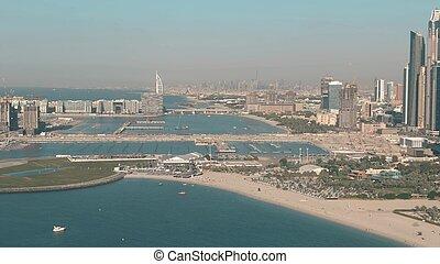 Aerial shot of Dubai coast and skyline as seen from the Dubai Marina area, UAE