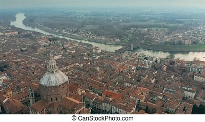 Aerial shot of Duomo di Pavia cathedral and the Ponte...