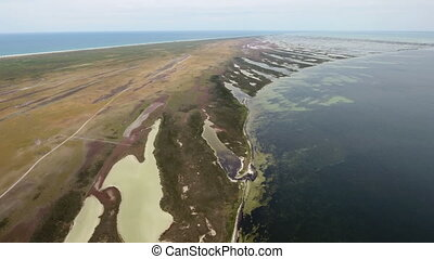 Aerial shot of Dzharylhach island and its stretched out wild...