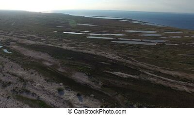 Aerial Shot of Dzharylhach Island Sandy Sea Beach With Small Ponds in Summer