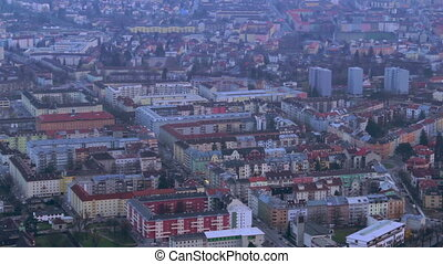Aerial shot of evening megalopolis, intensive traffic time...