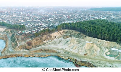 Aerial shot of evening sand excavation - Aerial shot of...