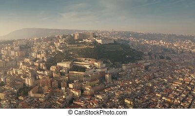 Aerial shot of Castel Sant'Elmo castle on the top of the hill and the cityscape of Naples