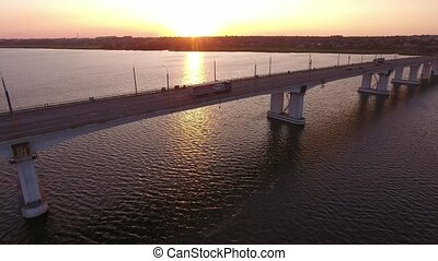 Aerial shot of far-off bridge with a moving semi-trailer...