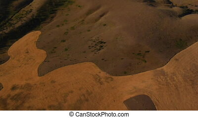 aerial shot of farm fields from above tilt up