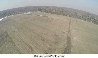 Aerial shot of farmlands in early spring, Russia