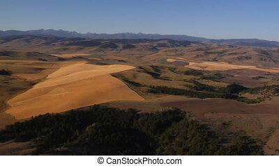aerial shot of fields with mountains in distance