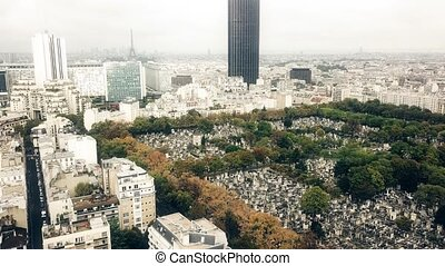 Aerial shot of foggy Paris cityscape, the Eiffel tower and...