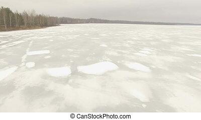 Aerial shot of frozen lake - Aerial shot moving over frozen...