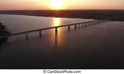 Aerial shot of gorgeous bridge covering the Dnipro at...