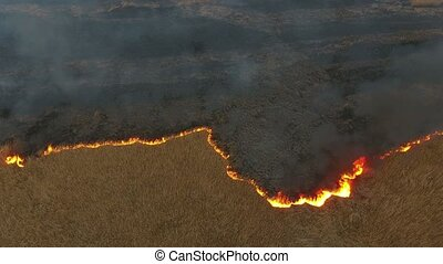 Aerial shot of gray smoke coils rising from flaming Dnipro...