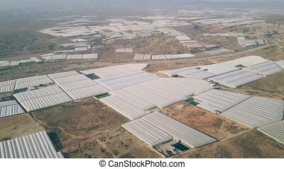 Aerial shot of greenhouse farms - Aerial view of greenhouse...