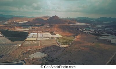 Aerial shot of greenhouses and fruit orchards in Andalusia,...