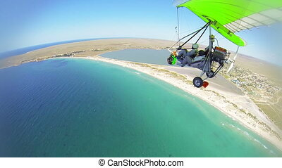 Aerial shot of hang gliding over shoreline GoPro Hero3 BE