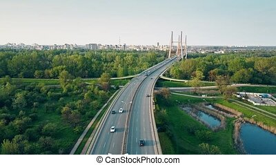 Aerial shot of highway and guyed car bridge in Warsaw.
