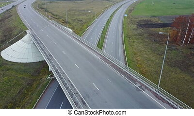 Aerial shot of highway junction with cars
