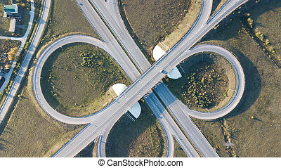Aerial shot of highway junction with cars top view in the ...