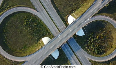 Aerial shot of highway junction with cars top view in the form of a sign of infinity