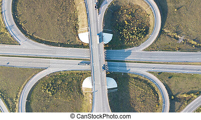 Aerial shot of highway junction with cars top view.