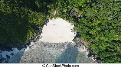 """Aerial shot of """"Holidays"""" written in the sand and people..."""