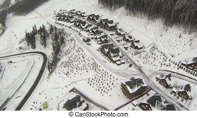 Aerial shot of houses on the hill