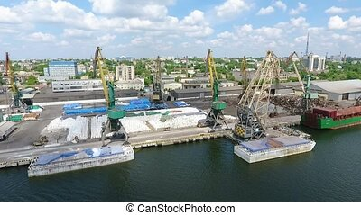 Aerial shot of huge cranes and docks in a city port at the Dnipro in summer