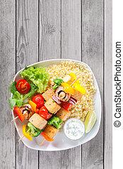 Aerial Shot of Kebabs on Rice with Veggies