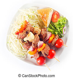 Aerial Shot of Kebabs with Bread and Veggies