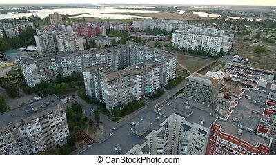 Aerial shot of Kherson city apartment blocks and the Dnipro  river seen faraway