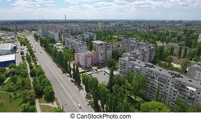 Aerial shot of Kherson city buildings divided by a long and...