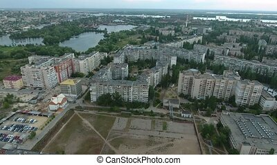 Aerial shot of Kherson city buildings and the Dnipro river...