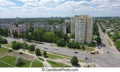 Aerial shot of Kherson city buildings with by a long and...